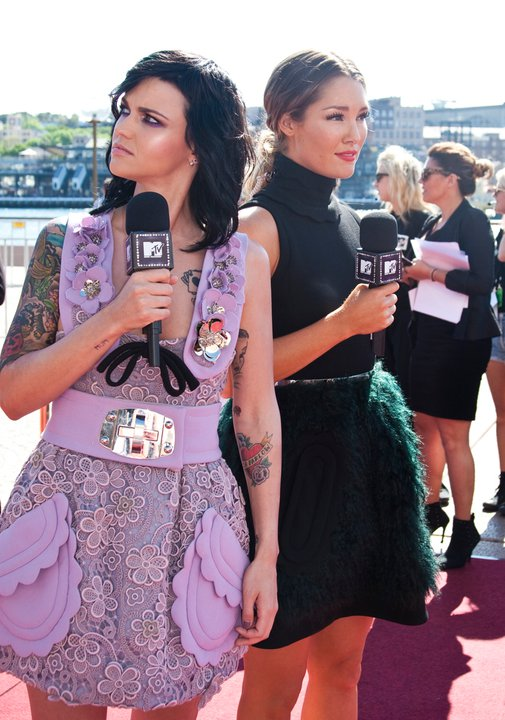 Hot MTV hostesses, Ruby Rose (wearing Prada and Miu Miu) & Erin McNaught, posing for on the red carpet.