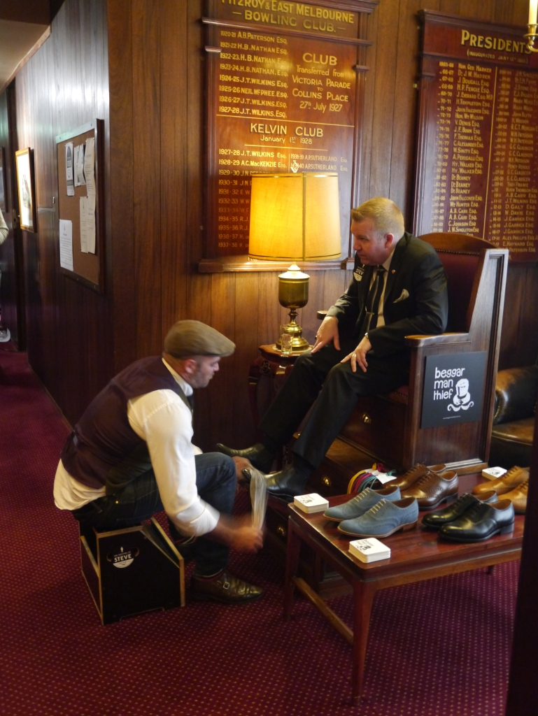 The dapper gents from Beggar Man Thief polishing the shoes of Mark Boldiston, owner of Lord Coconut.