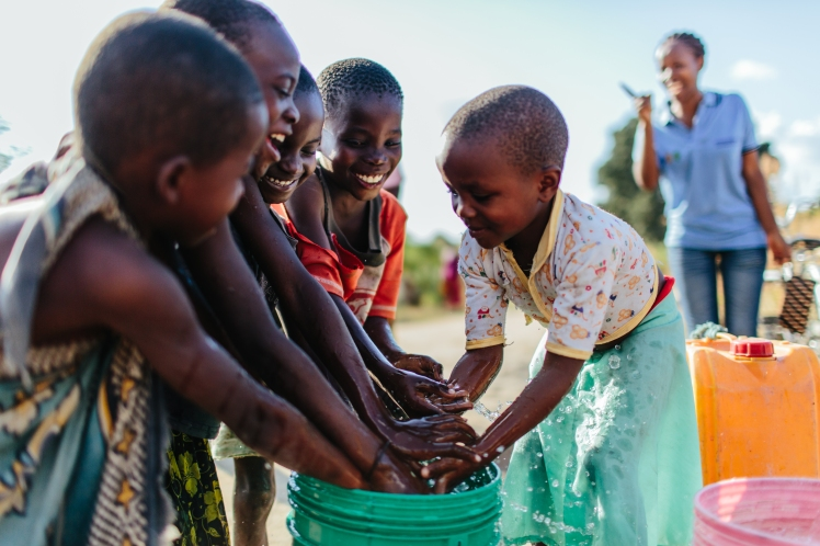 Children with clean water, Tanzania.jpg